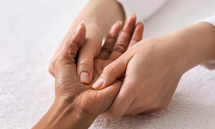 Acupuncture hand massage for black woman at spa