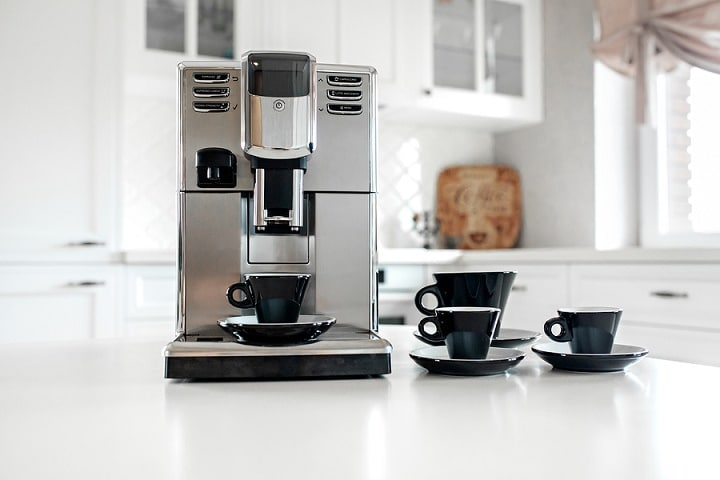 Coffee Machine With Cups For Espresso On The Kitchen Table. Clos